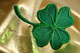 four leaf clover and shine of gold poster