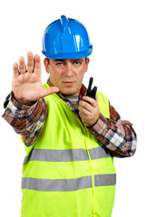construction worker talking with a walkie talkie a