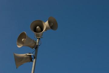loudspeaker detail with blue sky