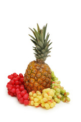 grapes and pineapple isolated on white background