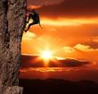 Leinwanddruck Bild - climber on sanset
