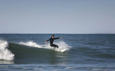 surfer making a forehand