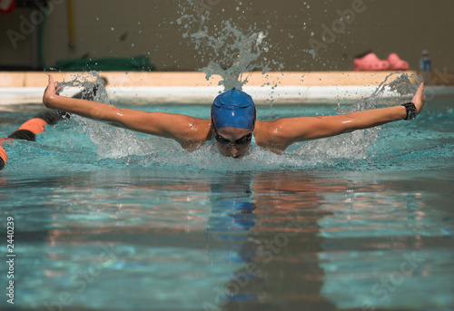 powerful female swimmer doing butterfly stoke