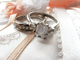 wedding ring and band - diamond and platinum on photo album poster