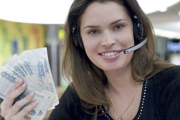 call center secretary with money in hand