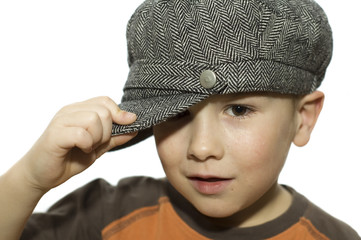 boy holding his hat
