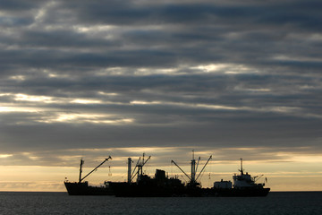 cargo boats at sunset