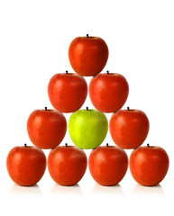 red apples on a pyramid shape - be different