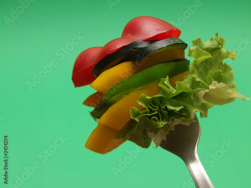 sliced vegetables on fork...