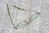 glasses on opened book poster