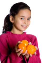 young girl offering oranges.