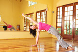 healthy young woman in gym outfit stretching poster