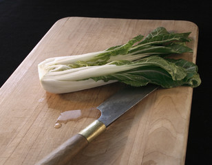 bok choy and knife on a cutting board