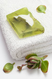 green soap on white towel poster