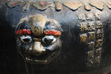 close-up of a face sculpture at a temple in china poster