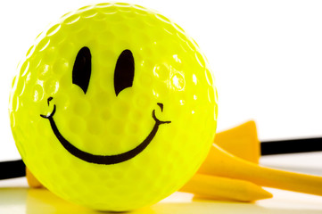 smiley face golf ball on white background