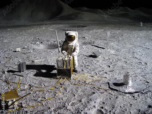 Leinwanddruck Bild astronaut collecting lunar artifacts