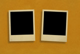 two old photo frames against rough paper poster