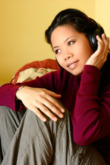 asian female enjoying her music.