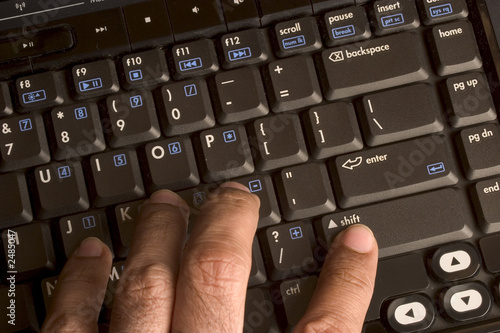 hands on laptop keyboard