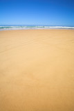 flat beach with blue sky poster