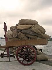 handcart full of bags in amsterdam harbor