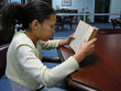 child reading in the library