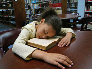 girl sleeping in the library