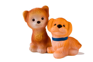 two rubber toy dogs.
