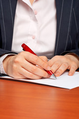 business woman writing a contract