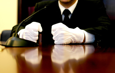 businessman with white gloves speaking