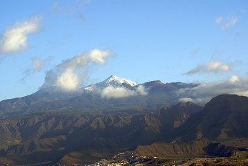 mt teide in clouds beyond la gomera