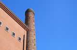 brick building and smokestack poster