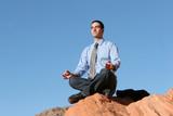 young business man meditating poster