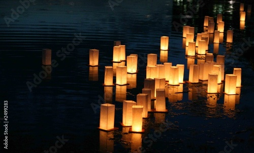 Foto Spatwand Japan japanese lanterns floating on a lake