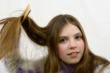 portrait of the young girl combing hair poster