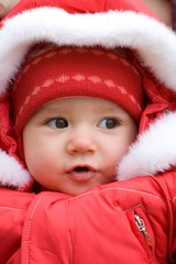 little girl wearing a red jacket