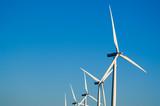 modern wind turbines or mills providing energy poster