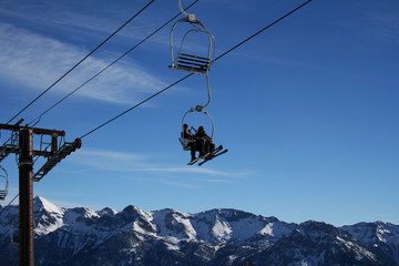 ski-lift on a blue sky
