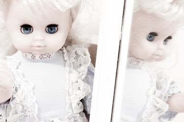 vintage doll at the mirror