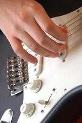 playing guitar-closeup