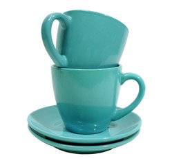 two blue cups with saucer over white background