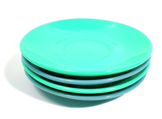 stack of green and blue plates on white background