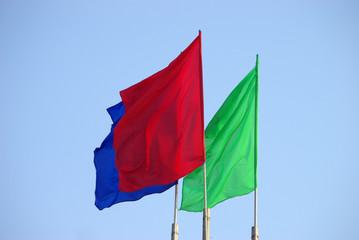 three colour flags waving