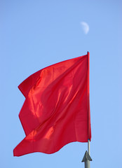 red flag and moon