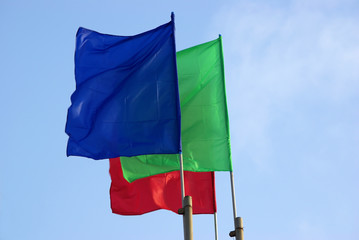 three colour flags waving and sky