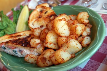 crab sandwich and fried potatoes