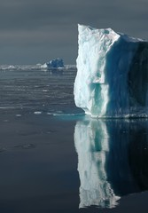 blue iceberg with water reflection