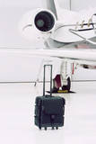luggage by private plane poster