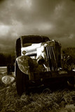 rusted out antique truck. poster